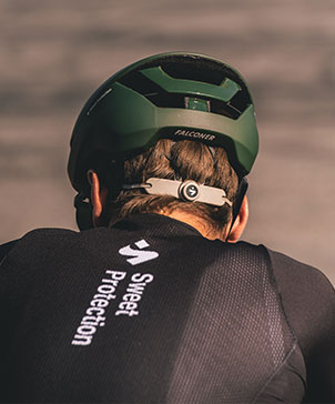 A man on bicycle with bicycle clothes and bicycle helmet from Sweet Protection.