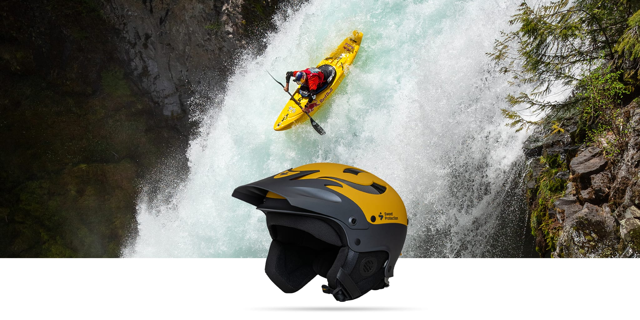 A man with paddlesport helmet kayaking down the waterfall.