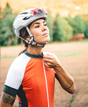 Mari  with bicycle helmet and cycling clothing from sweet protection