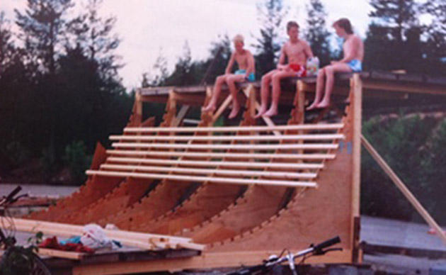 Bushmade Skateboards   Three guys are sitting on a 7-meter-high vert ramp hidden in the woods.