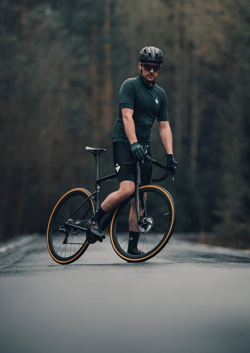 Man on bike with bike helmet and cycling gear from Sweet Protection