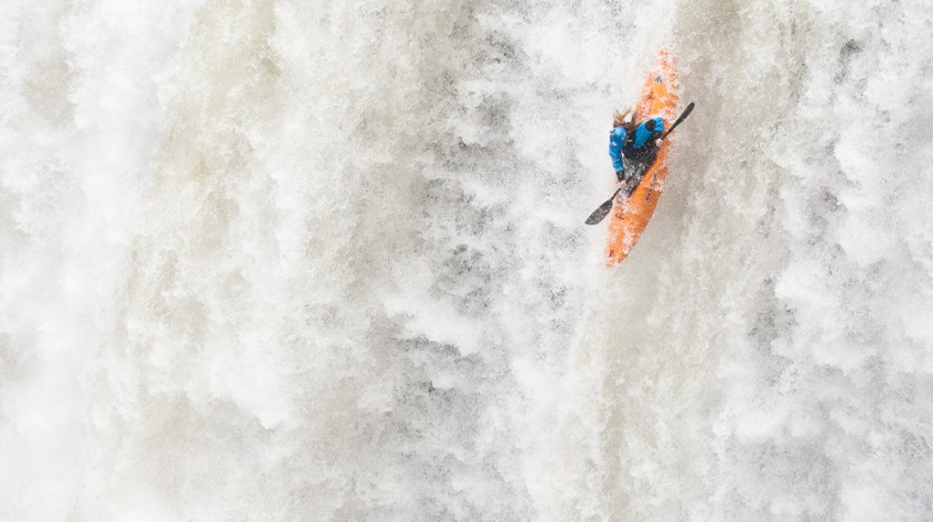 Mariann Sæther kayaks down the waterfall | Sweet Protection